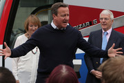 """British Prime Minister David Cameron addresses pro-EU """"Vote Remain"""" supporters with Labour MP Harriet Harman (L) and former Conservative Prime Minister Sir John Major at his side during a rally on June 22, 2016 in Bristol, United Kingdom. The final day of campaigning continues across the UK as the country prepares to go to the polls on June 23rd to decide whether Britain should remain or leave the European Union."""