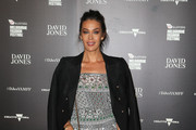 Megan Gale poses as she arrives for the David Jones opening event as part of Virgin Australia Melbourne Fashion Festival on March 7, 2016 in Melbourne, Australia.