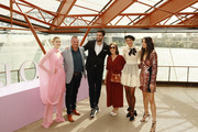 Victoria Lee, Chris Wilson, Tom Derickx, Bridget Veals, Dilone and Jessica Gomes pose during the Fashion Presentation at the David Jones SS19 Season Preview at the Sydney Opera House on August 08, 2019 in Sydney, Australia.
