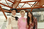 Dilone, Victoria Lee and Jessica Gomes  arrive at the David Jones SS19 Season Preview at the Sydney Opera House on August 08, 2019 in Sydney, Australia.