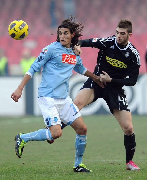 SSC Napoli v AC Cesena - Serie A [davide santon of cesena,player,soccer,sports,sports equipment,team sport,ball game,football player,soccer player,football,soccer ball,tussles with,r,italy,naples,ssc napoli,ac cesena,serie a,edinson cavani of napoli,serie a match between ssc napoli]