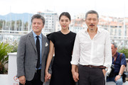 """Actors Haehyo Kwon, Kim Min Hee and director Hong SangSoo  attend """"The Day After (Geu Hu)"""" photocall during the 70th annual Cannes Film Festival at Palais des Festivals on May 22, 2017 in Cannes, France."""