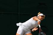 Sabine Lisicki of Germany serves during the Mixed Doubles first round match against Scott Lipsky of the United States and Alla Kudryavtseva of Russia on day five of the Wimbledon Lawn Tennis Championships at the All England Lawn Tennis and Croquet Club on July 7, 2017 in London, England.