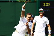 (L-R) Bruno Soares of Brazil and Jamie Murray of Great Britain return a shot against Paolo Lorenzi of Italy and Albert Ramos-Vinolas of Spain during their Men's Doubles first round match on day five of the Wimbledon Lawn Tennis Championships at All England Lawn Tennis and Croquet Club on July 6, 2018 in London, England.
