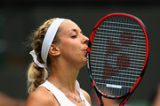 Sabine Lisicki of Germany plays a reacts against Christina McHale of USA in her Women's Singles Second Round match during day four of the Wimbledon Lawn Tennis Championships at the All England Lawn Tennis and Croquet Club on July 2, 2015 in London, England.