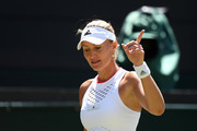 Kristina Mladenovic of France reacts  in her Ladies' Singles second round match against Petra Kvitova of The Czech Republic  during Day four of The Championships - Wimbledon 2019 at All England Lawn Tennis and Croquet Club on July 04, 2019 in London, England.