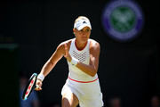 Kristina Mladenovic of France in her Ladies' Singles second round match against Petra Kvitova of The Czech Republic  during Day four of The Championships - Wimbledon 2019 at All England Lawn Tennis and Croquet Club on July 04, 2019 in London, England.