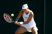 Angelique Kerber of Germany plays a backhand in her Ladies' Singles second round match against Lauren Davis of The United States during Day four of The Championships - Wimbledon 2019 at All England Lawn Tennis and Croquet Club on July 04, 2019 in London, England.
