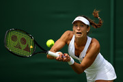 Vitalia Diatchenko of Russia plays a forehand in her Ladies's Singles first round match against Anna-Lena Friedsam of Germany during day one of the Wimbledon Lawn Tennis Championships at the All England Lawn Tennis and Croquet Club on June 29, 2015 in London, England.