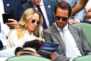 Sir Ben Ainslie (R) and his wife Georgie Thompson attends day seven of the Wimbledon Lawn Tennis Championships at All England Lawn Tennis and Croquet Club on July 9, 2018 in London, England.