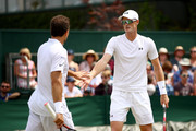 Jamie Murray of Great Britain and Bruno Soares of Brazil celebrate a point against Ken Skupski and Neal Skupski of Great Britain during their Men's Doubles third round match on day seven of the Wimbledon Lawn Tennis Championships at All England Lawn Tennis and Croquet Club on July 9, 2018 in London, England.