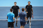 Jamie Murray of Great Britain and Bruno Soares of Brazil show their dejection as they approach the net to shake hands after their straight sets defeat by Henri Kontinen of Finland and John Peers of Australia in their mens doubles semi final match at the Nitto ATP World Tour Finals at O2 Arena on November 18, 2017 in London, England.
