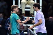 Belgium's David Goffin (L) shakes hands after beating Switzerland's Roger Federer (R) during their men's singles semi-final match on day seven of the ATP World Tour Finals tennis tournament at the O2 Arena in London on November 18, 2017..David Goffin won 2-6, 6-3, 6-4.  / AFP PHOTO / Glyn KIRK