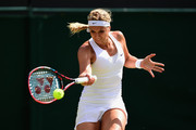 Sabine Lisicki of Germany plays a forehand in her LadiesÂ' Singles Third Round match against Timea Bacsinszky of Switzerland during day six of the Wimbledon Lawn Tennis Championships at the All England Lawn Tennis and Croquet Club on July 4, 2015 in London, England.