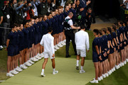 Novak Djokovic of Serbia and Roger Federer of Switzerland walk off the court after their Men's Singles final during Day thirteen of The Championships - Wimbledon 2019 at All England Lawn Tennis and Croquet Club on July 14, 2019 in London, England.