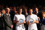 John Peers of Australia and Jamie Murray of Great Britain hold the runner-up plates with Prince Edward, Duke of Kent after losing in the Final Of The Gentlemen's Doubles against Horia Tecau of Romania and Jean-Julien Rojer of Netherland during day twelve of the Wimbledon Lawn Tennis Championships at the All England Lawn Tennis and Croquet Club on July 11, 2015 in London, England.
