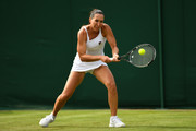 Jelena Jankovic of Serbia plays a forehand during the Ladies Singles first round match against Agnieszka Radwanska of Poland on day two of the Wimbledon Lawn Tennis Championships at the All England Lawn Tennis and Croquet Club on July 4, 2017 in London, England.