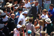 Rafael Nadal of Spain (C) walks through a crowd of fans after his warm up session on day two of the Wimbledon Lawn Tennis Championships at All England Lawn Tennis and Croquet Club on July 3, 2018 in London, England.