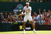 Rafael Nadal of Spain returns against Dudi Sela of Isreal during his Men's Singles first round match against on day two of the Wimbledon Lawn Tennis Championships at All England Lawn Tennis and Croquet Club on July 3, 2018 in London, England.