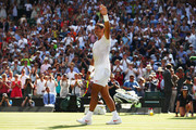 Rafael Nadal of Spain celebrates match point against Dudi Sela of Isreal during their Men's Singles first round match on day two of the Wimbledon Lawn Tennis Championships at All England Lawn Tennis and Croquet Club on July 3, 2018 in London, England.