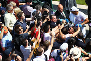 Tennis fans use their phones to take pictures of Rafael Nadal of Spain (L) during his warm up session on day two of the Wimbledon Lawn Tennis Championships at All England Lawn Tennis and Croquet Club on July 3, 2018 in London, England.