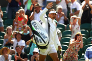 Rafael Nadal of Spain waves to the crowd prior to his Men's Singles first round match against Dudi Sela of Israel on day two of the Wimbledon Lawn Tennis Championships at All England Lawn Tennis and Croquet Club on July 3, 2018 in London, England.
