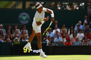 Rafael Nadal of Spain serves against Dudi Sela of Isreal during his Men's Singles first round match against on day two of the Wimbledon Lawn Tennis Championships at All England Lawn Tennis and Croquet Club on July 3, 2018 in London, England.