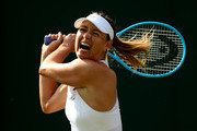 Maria Sharapova of Russia plays a forehand in her Ladies' Singles first round match against Pauline Parmentier of France during Day two of The Championships - Wimbledon 2019 at All England Lawn Tennis and Croquet Club on July 02, 2019 in London, England.