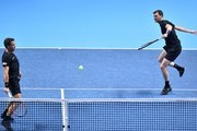 Britain's Jamie Murray (R) returns as his partner Brazil's Bruno Soares (L) stands ready against USA's Bob Bryan and USA's Mike Bryan during their men's doubles match on day two of the ATP World Tour Finals tennis tournament at the O2 Arena in London on November 13, 2017. / AFP PHOTO / Glyn KIRK