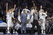 Collin Gillespie #2, Dhamir Cosby-Roundtree #21, Mikal Bridges #25, Phil Booth #5 and Donte DiVincenzo #10 of the Villanova Wildcats celebrate from the bench while head coach Jay Wright looks on after a three-point basket by Denny Grace in the second half against the DePaul Blue Demons at the Wells Fargo Center on February 21, 2018 in Philadelphia, Pennsylvania. The Villanova Wildcats defeated the DePaul Blue Demons 93-62.