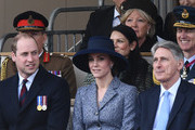 Britain's Prince William, Duke of Cambridge, (front row, L), Britain's Catherine, Duchess of Cambridge, (front row, centre) and British Chancellor of the Exchequer Philip Hammond (front row, R) attend a Service of Commemoration and Drumhead Service on Horse Guards Parade in central London on March 9, 2017, which honours the service and duty of both the UK Armed Forces and civilians in the Gulf region, Iraq and Afghanistan, and those who supported them back home, from 1990-2015..After the Drumhead Service, The Queen will officially unveil The Iraq and Afghanistan memorial. / AFP PHOTO / Justin TALLIS