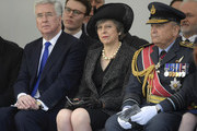 """British Defence Secretary Michael Fallon (L), British Prime Minister Theresa May (C) and Air Chief Marshal, Sir Stuart Peach, chief of the defence staff (R) attend the unveiling of The Iraq and Afghanistan memorial at Victoria Embankment Gardens in central London on March 9, 2017..The preceding """"Service of Dedication"""" honoured the service and duty of both the UK Armed Forces and civilians in the Gulf region, Iraq and Afghanistan, and those who supported them back home, from 1990-2015 / AFP PHOTO / POOL / Toby Melville"""