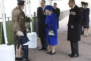 Alfie Lun, 2, and his mother Michelle stands before handing a bouquet to Queen Elizabeth II as Prince Philip, Duke of Edinburgh looks on during the unveiling of the new memorial to members of the armed services who served and died in the wars in Iraq and Afghanistan at Victoria Embankment Gardens on March 8, 2017 in London, England.