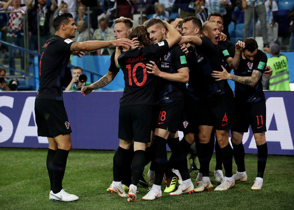 Argentina vs. Croatia: Group D - 2018 FIFA World Cup Russia [player,sports,team sport,ball game,team,sport venue,social group,football player,sports equipment,tournament,ante rebic,teammates,goal,russia,argentina,croatia,nizhny novgorod stadium,croatia: group d,team,2018 fifa world cup]