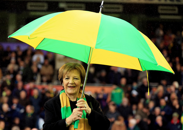 Norwich City vs. Leeds United - Sky Bet Championship [green,people,product,umbrella,yellow,crowd,event,fan,audience,fashion accessory,delia smith,norwich,england,carrow road,norwich city,leeds united,sky bet championship,match]