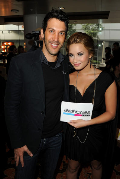 Demi Lovato Executive Producer Assaf Blecher (L) and Recording artist Demi Lovato attend the 2010 American Music Awards Nominations Press Conference held at The Mixing Room at the JW Marriott Los Angeles at L.A. LIVE on October 12, 2010 in Los Angeles, California.