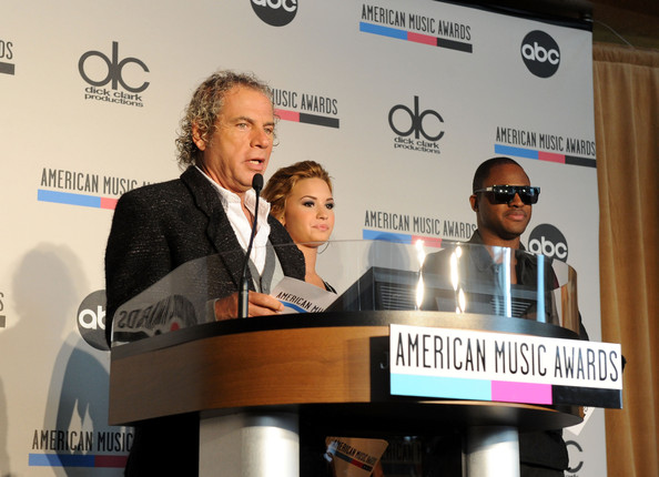 Demi Lovato (L-R) DCP Producer Larry Klein, recording artists Demi Lovato and Taio Cruz speak at the 2010 American Music Awards Nominations Press Conference held at The Mixing Room at the JW Marriott Los Angeles at L.A. LIVE on October 12, 2010 in Los Angeles, California.