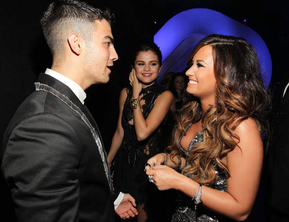 Demi Lovato Singer Joe Jonas, actress Selena Gomez, and singer Demi Lovato arrives at the 2011 MTV Video Music Awards at Nokia Theatre L.A. LIVE on August 28, 2011 in Los Angeles, California.