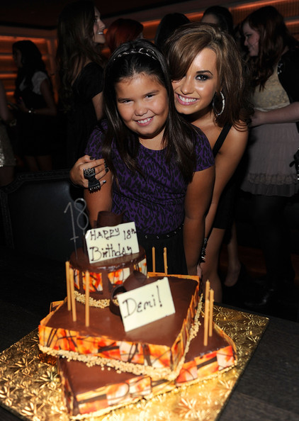 Demi Lovato (EXCLUSIVE ACCESS - PREMIUM RATES APPLY) Madison DeLaGarza and Demi Lovato with birthday cake at Demi Lovato's 18th birthday party at Buddakan on August 19, 2010 in New York City.