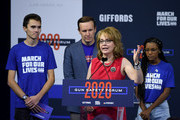Former U.S. Rep. Gabrielle Giffords, flanked by (L-R) March for Our Lives Co-Founder David Hogg, U.S. Sen. Chris Murphy (D-CT) and March for Our Lives board member Ariel Hobbs, speaks during the 2020 Gun Safety Forum hosted by gun control activist groups Giffords and March for Our Lives at Enclave on October 2, 2019 in Las Vegas, Nevada. Nine Democratic candidates for president are taking part in the forum to address gun violence one day after the second anniversary of the massacre at the Route 91 Harvest country music festival in Las Vegas when a gunman killed 58 people in the deadliest mass shooting in recent U.S. history.