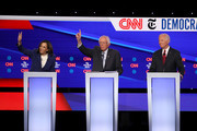 Sen. Kamala Harris (D-CA) and Sen. Bernie Sanders (I-VT) raise their hands as former Vice President Joe Biden look on during the Democratic Presidential Debate at Otterbein University on October 15, 2019 in Westerville, Ohio. A record 12 presidential hopefuls are participating in the debate hosted by CNN and The New York Times.