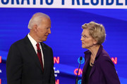 Former Vice President Joe Biden and Sen. Elizabeth Warren (D-MA) react  during a break at the Democratic Presidential Debate at Otterbein University on October 15, 2019 in Westerville, Ohio. A record 12 presidential hopefuls are participating in the debate hosted by CNN and The New York Times.