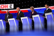 Sen. Bernie Sanders (I-VT), former Vice President Joe Biden, Sen. Elizabeth Warren (D-MA), and South Bend, Indiana Mayor Pete Buttigieg look down during the Democratic Presidential Debate at Otterbein University on October 15, 2019 in Westerville, Ohio. A record 12 presidential hopefuls are participating in the debate hosted by CNN and The New York Times.