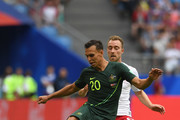 Denmark player Christian Eriksen is challenged by Trent Sainsbury of Australia during the 2018 FIFA World Cup Russia group C match between Denmark and Australia at Samara Arena on June 21, 2018 in Samara, Russia.