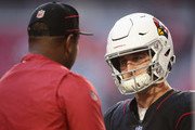Quarterback Josh Rosen #3 of the Arizona Cardinals talks with quarterback coach Byron Leftwich before the NFL game against the Denver Broncos at State Farm Stadium on October 18, 2018 in Glendale, Arizona.