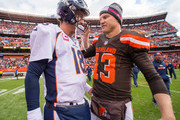 Quarterbacks Peyton Manning #18 of the Denver Broncos and Josh McCown #13 of the Cleveland Browns talk after the game at FirstEnergy Stadium on October 18, 2015 in Cleveland, Ohio. The Broncos defeated the Browns 26-23 in overtime.