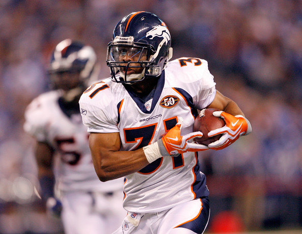 Darcel McBath #31 of the Denver Broncos runs with the ball after intercepting a pass during the NFL game against the <a class='sbn-auto-link' href=
