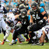 T.J. Yeldon #24 of the Jacksonville Jaguars runs for yardage as behind the block of Christopher Reed #64 as ared Crick #93 of the Denver Broncos defends at EverBank Field on December 4, 2016 in Jacksonville, Florida.