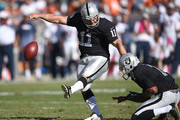 Sebastian Janikowski #11 of the Oakland Raiders attempts a field goal against the Denver Broncos at O.co Coliseum on October 11, 2015 in Oakland, California.