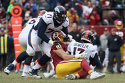 Offensive tackle Donald Stephenson #71 of the Denver Broncos attempt to block outside linebacker Ryan Kerrigan #91 of the Washington Redskins as he sacks quarterback Brock Osweiler #17 in the second half at FedExField on December 24, 2017 in Landover, Maryland.